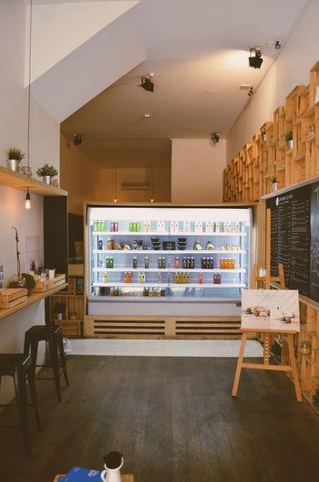 Juice bottles in illuminated refrigerator in cafe