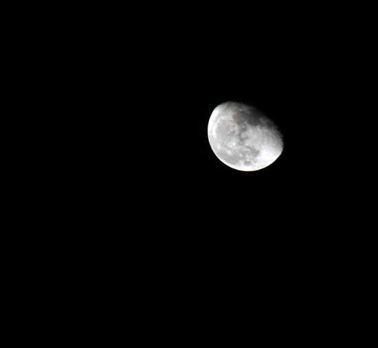 Astronomy Beauty In Nature Black Background Copy Space Dark Full Moon Half Moon Low Angle View Moon Moon Surface Nature Night No People Outdoors Planetary Moon Scenics Sky Space Tranquil Scene Tranquility