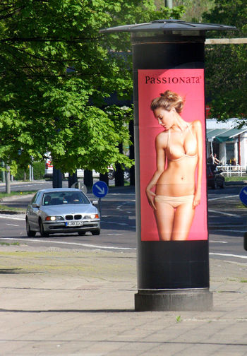 A Taste Of Berlin Berlin Photography Street Advertising Car Communication Day Full Length Lifestyles One Person Outdoors People Real People Shirtless Standing Tree Young Adult Berlin Love #FREIHEITBERLIN #urbanana: The Urban Playground