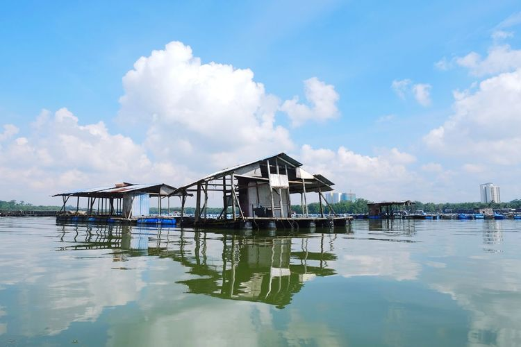 Eyeem Everywhere Kelong Water Sky Cloud - Sky Built Structure Architecture Waterfront Reflection Building Exterior Residential District Nature Building Nautical Vessel Day House No People Stilt House Stilt Lake Beauty In Nature Outdoors