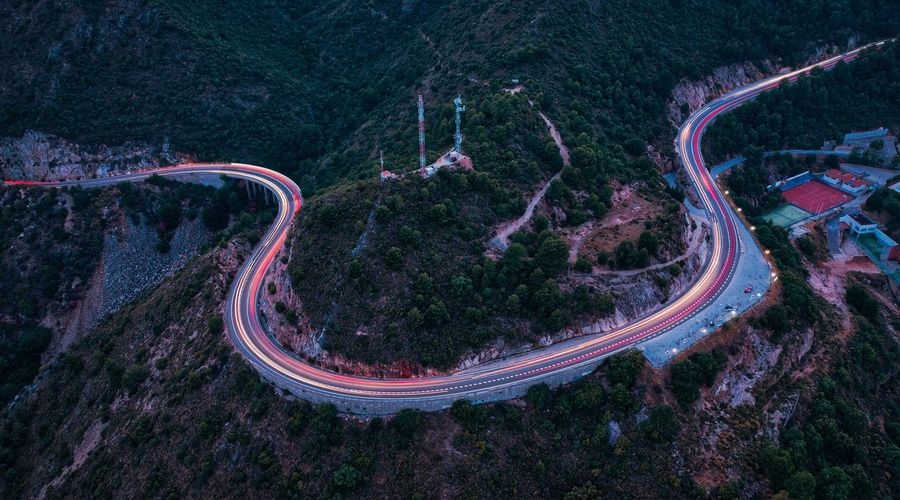 Aerial view of winding road at dusk