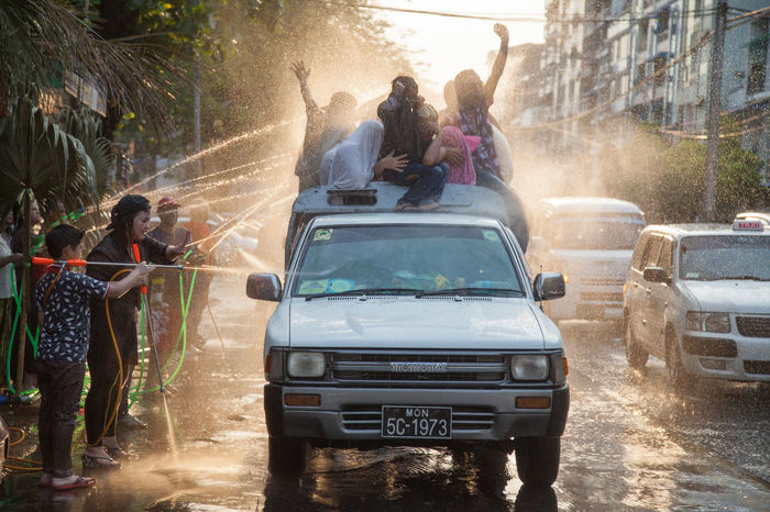 Roadside water jets soak a load of locals packed into a truck bed during the Thingyan festival in Yangon. Burma Car Celebration Culture Festival Myanmar People Thingyan  Thingyan Water Festival Thingyanfestival Travel Water Water Festival Yangon First Eyeem Photo