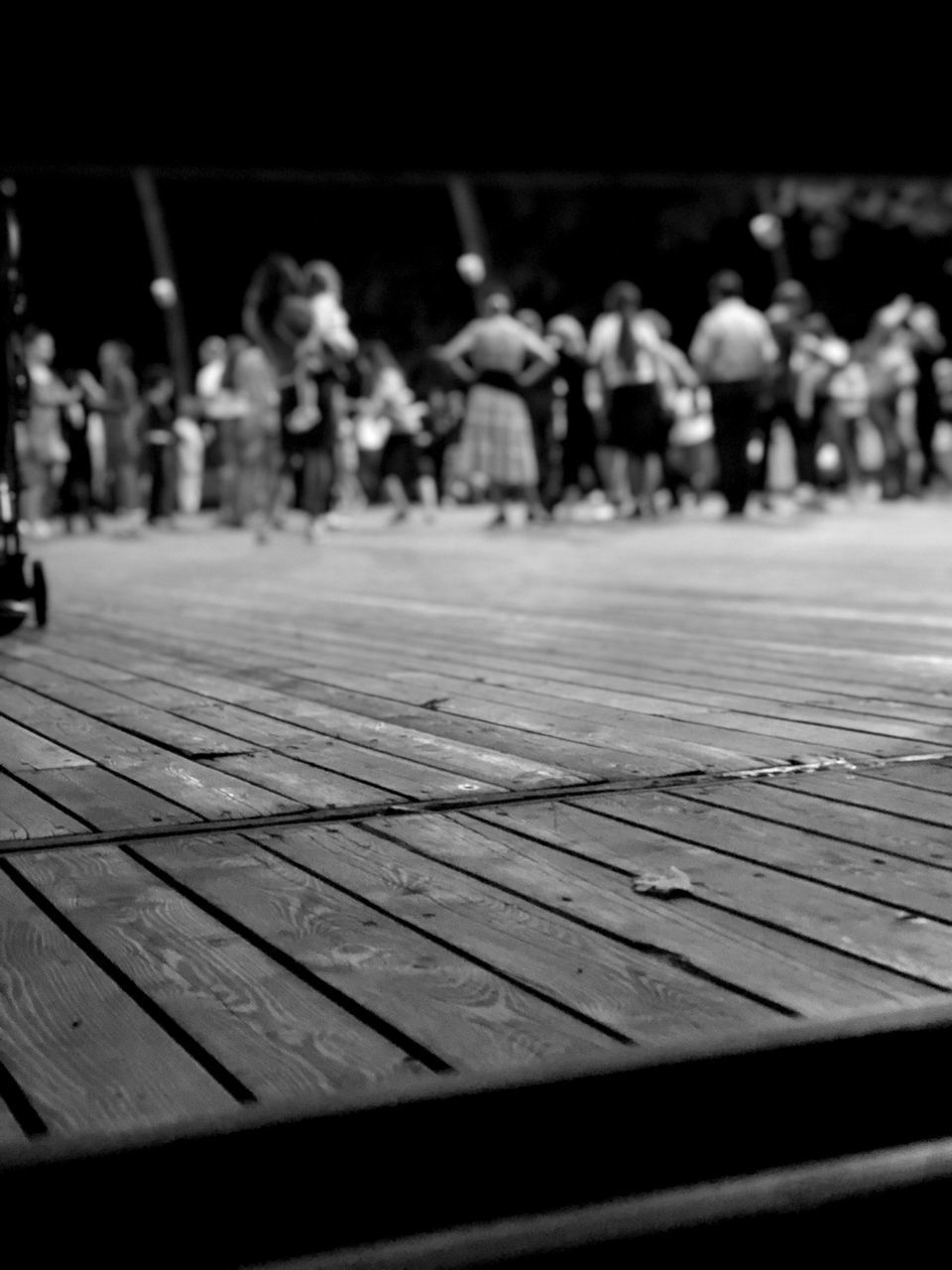CLOSE-UP OF GROUP OF PEOPLE ON WOODEN SURFACE