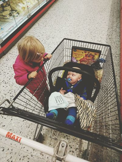 The team leaders Grocery Shopping Shopping Cart Baby Boy Girl Pink Blue EyeEm Gallery People Family Childhood Telling Stories Differently Children Photography People Together Family Time Siblings EyeEmBestPics EyeEm Best Shots Kidsphotography Market Conference Partnersincrime Hanging Out The Moment - 2016 Eyeem Awards People Photography