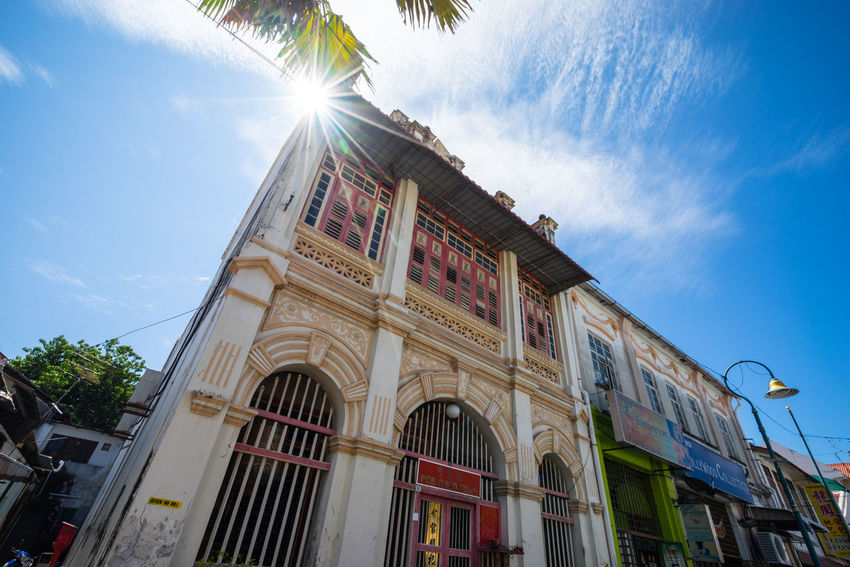Penang Street Art has become a vibrant showcase for street art since it was listed as a World Heritage Site in 2008. A walk amongst this will bring history to you. Daylight Photography Old Town Penang Malaysia Street Photography