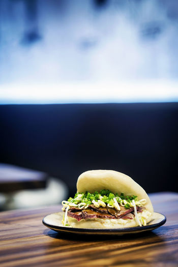asian style bao pork sandwich Asian Snack Chinese Food Food And Drink Sandwich Snack Tapas Asian Food Asian Sandwich Bao Close-up Food Food And Drink Freshness Fusion Food Healthy Eating Hipster No People Plate Pork Sandwich Ready-to-eat Table Trendy Food