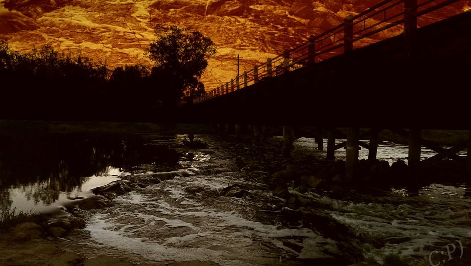 Fire in the sky, under the bridge on the walk home. Bridge Sunset River Water RedSky Beverley Australia Wheatbelt WA Avon River it's actually 3 photos taken at slightly different times then layered over each other with a few adjustments made.