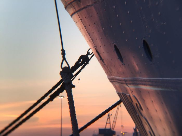 Low angle view of ship during sunset