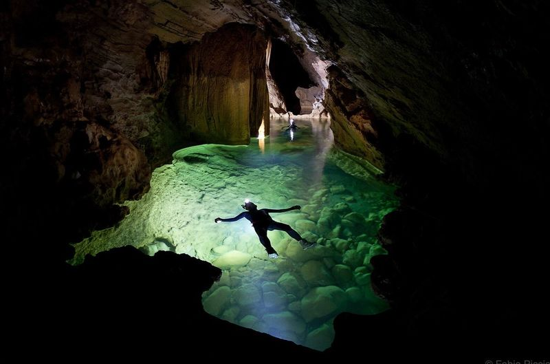 High Angle View Of Person Floating In Water In Cave