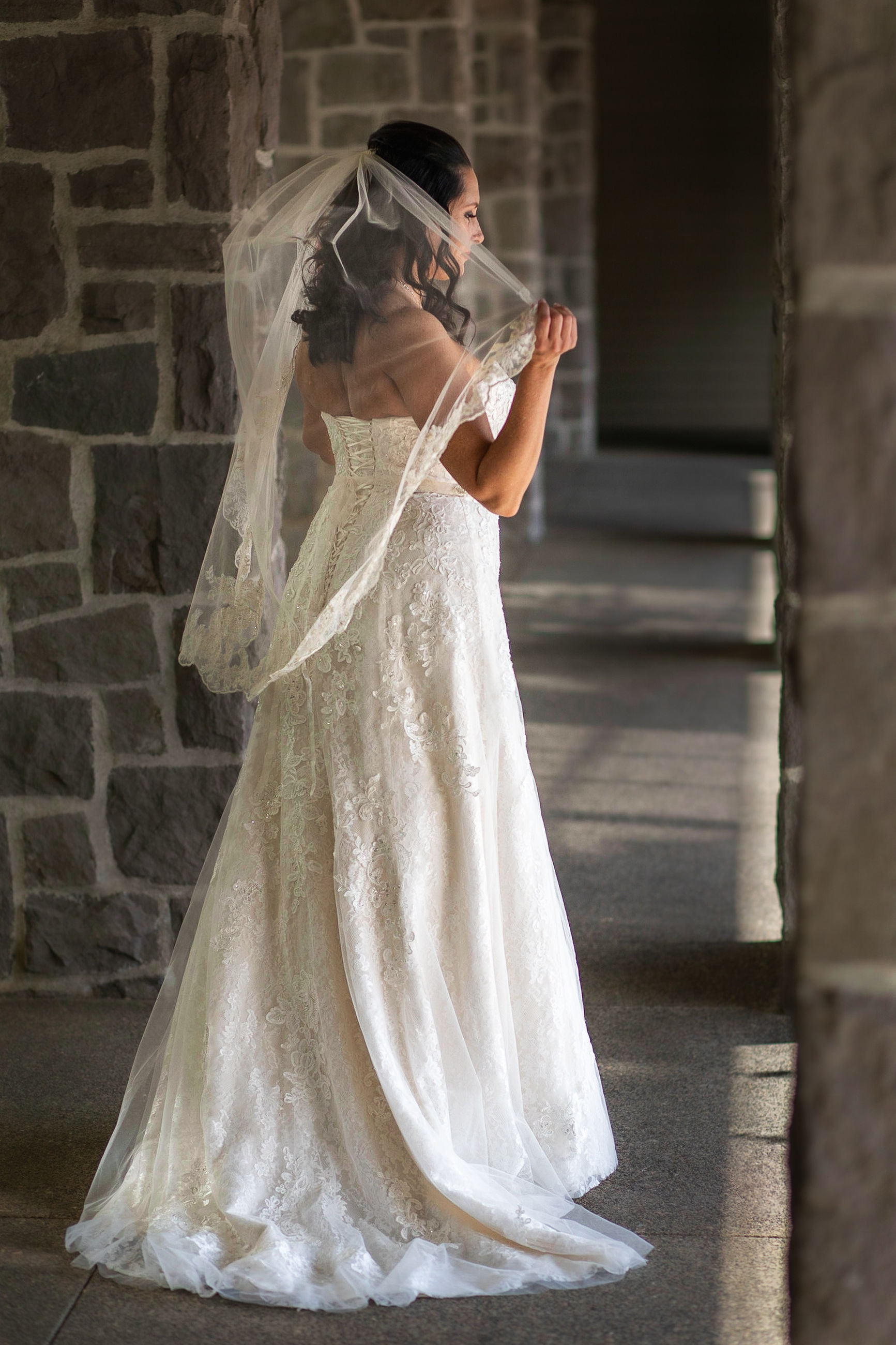 women, wedding, real people, one person, wedding dress, standing, newlywed, celebration, bride, event, full length, fashion, side view, adult, white color, lifestyles, young adult, life events, built structure, veil