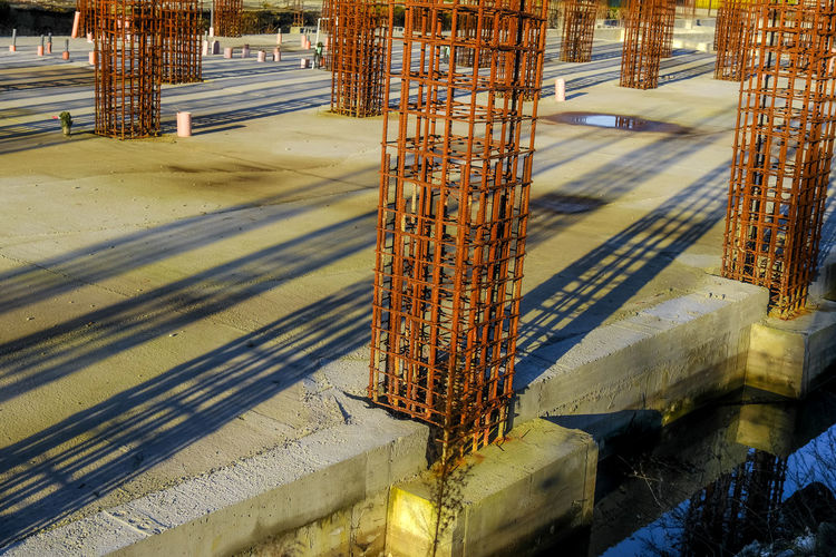 High angle view of metallic structure on road by building