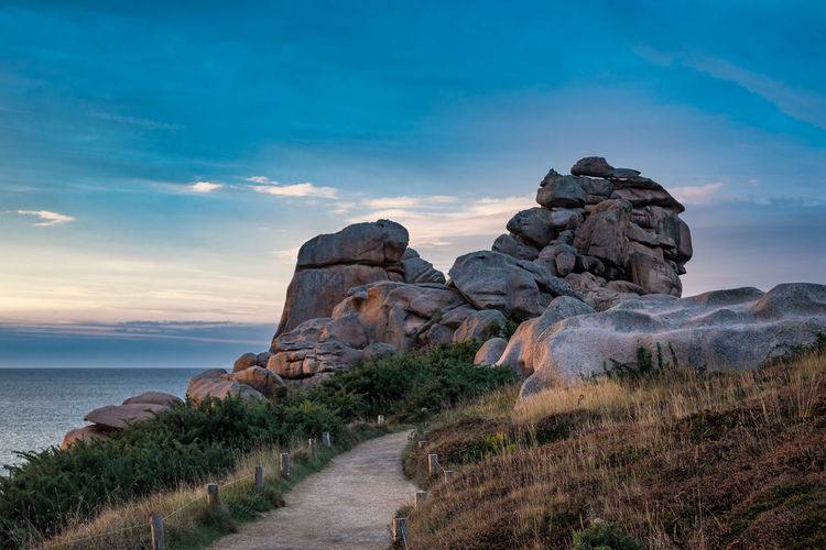 Atlantic Sea coast in the Brittany, France. Atlantic Ocean Beauty In Nature Brittany Coast Day Footpath Journey Landscape Nature Nature No People Outdoors Pink Granite Coast Ploumanac'h Rock - Object Scenics Sea Shore Sky Stones Tourism Travel Travel Destinations Water Way