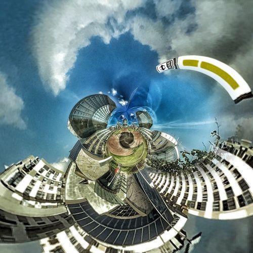 Digital composite image of buildings against sky