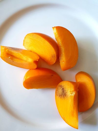 High angle view of orange fruit in plate