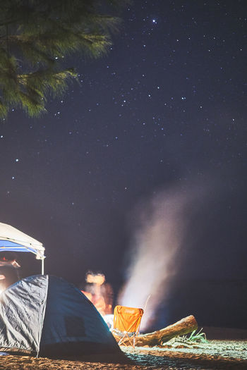 Camping under stars Bonfire Camping Camping Out Night Photography Astrophotography Beach Beauty In Nature Illuminated Nature Night Nightshot No People Outdoor Photography Outdoors Scenics Sky Star - Space Stars Tent Tentacle Tree Water