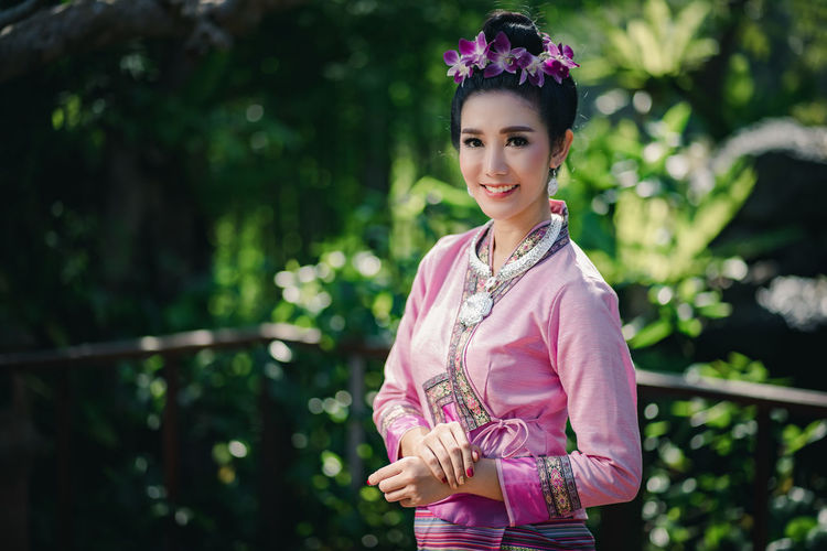 Beautiful Thai woman with traditional Lanna cloth. One Person Smiling Real People Standing Young Adult Lifestyles Portrait Women Looking At Camera Young Women Leisure Activity Plant Focus On Foreground Beautiful Woman Adult Happiness Day Nature Beauty Hairstyle Outdoors Thailand Lanna Culture Traditional Clothing Thai Travel Dress Old-fashioned Antique