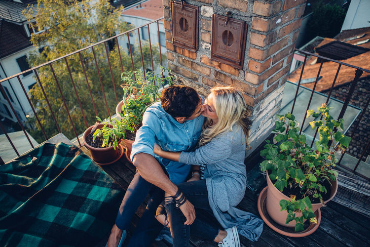High angle view of couple kissing in balcony