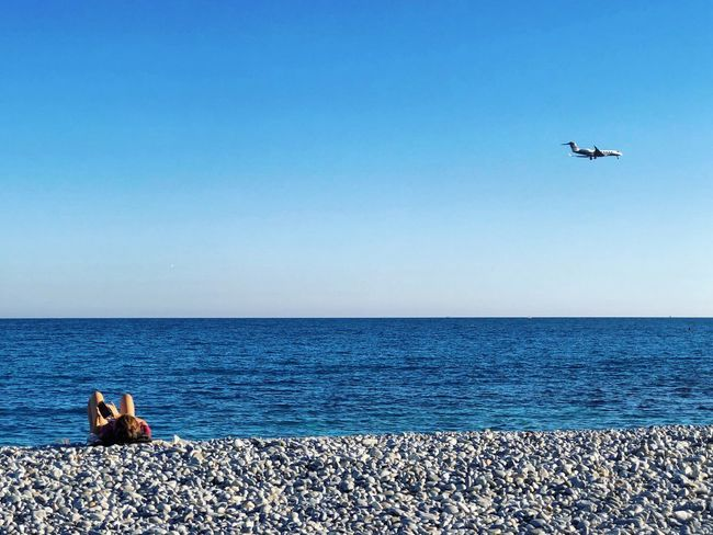 Always on Smart Phone Mobile person Water Horizon Over Water Sea Horizon Sky Beauty In Nature Nature Scenics - Nature Blue Clear Sky Day Flying Beach Tranquil Scene Land