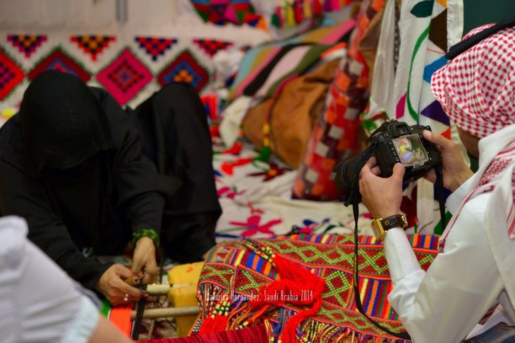A Bedouin of Saudi Arabia is performing her craft. Cutural Arts at the Arab Summer Fair Taking Photos Of People Taking Photos Hands On