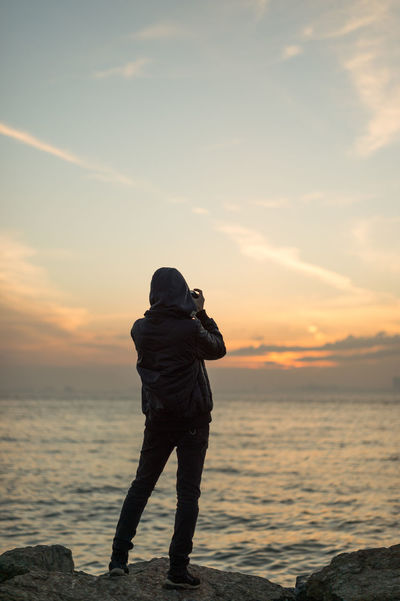 Capturing the Moment II Istanbul Man Beauty In Nature Bosphorus Full Length Horizon Over Water Nature One Person Outdoors Photographing Photography Themes Real People Rear View Scenics Sea Sea And Sky Silhouette Sky Standing Sunset Tranquil Scene Urban People Vacations Water