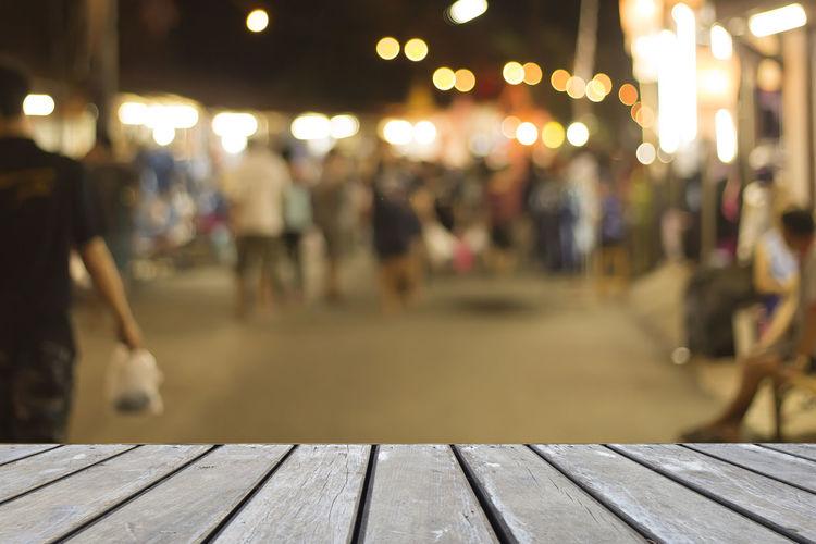 Table Against Illuminated Defocused Lights At Night