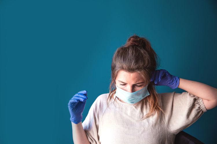 Portrait of a woman against blue background