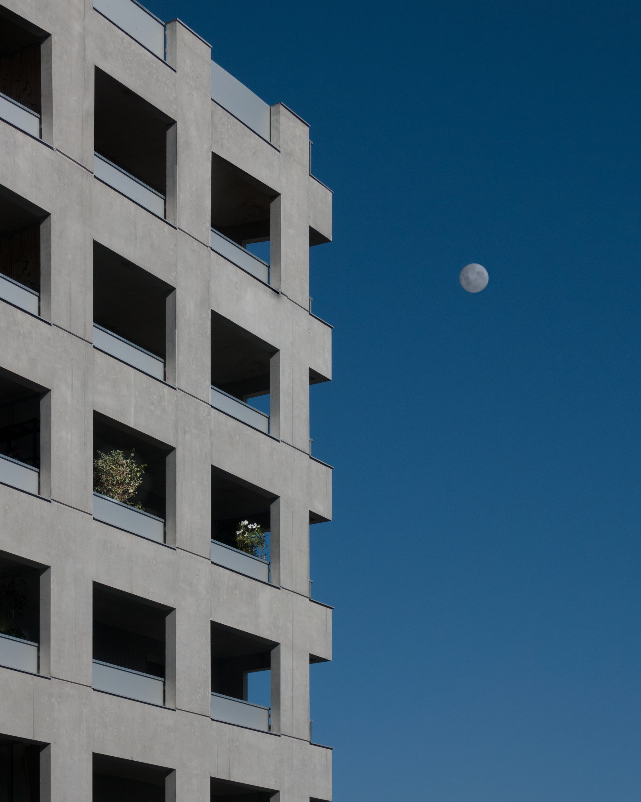 sky, built structure, architecture, building exterior, moon, building, clear sky, blue, no people, low angle view, nature, window, outdoors, city, sunlight, tall - high, copy space, modern, apartment