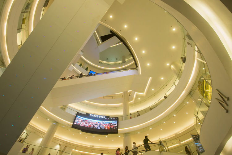 Low angle view of led tv in shopping mall