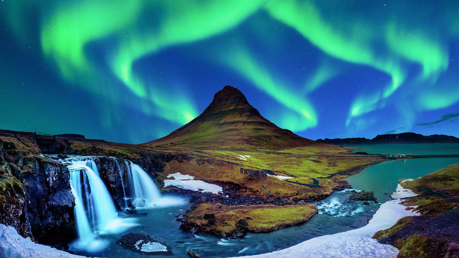 Northern Light, Aurora borealis at Kirkjufell in Iceland. Kirkjufell mountains in winter. Astronomy Beauty In Nature Cold Temperature Environment Flowing Water Green Color Idyllic Landscape Long Exposure Mountain Nature Night No People Non-urban Scene Scenics - Nature Sky Star - Space Tranquil Scene Tranquility Water