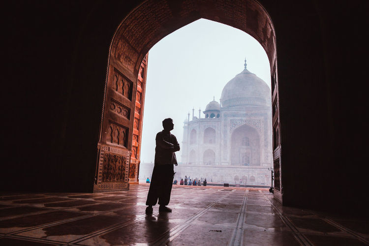 Silhouette Man Standing By Arch Against Taj Mahal