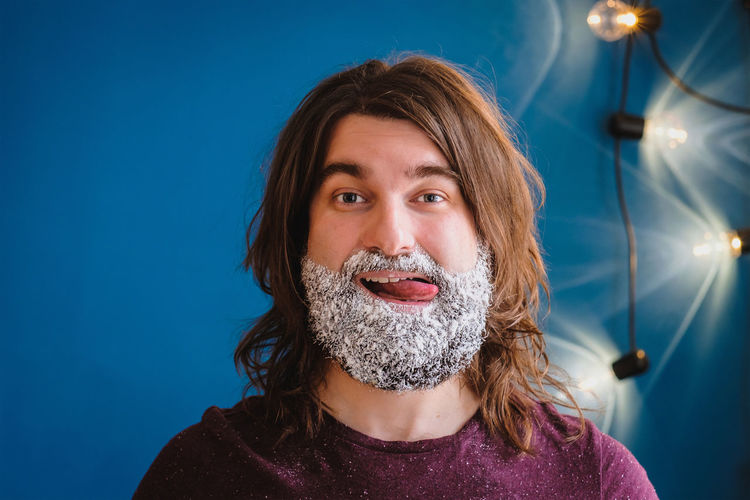 merry christmas and happy chanukah with a lot of sugar for everyone! Arts Culture And Entertainment Beard Blue Blue Background Happy Chanukah Headshot Lights Looking At Camera MerryChristmas Mouth Open One Person Portrait Sugar Sugar Beard White White Beard White Christmas