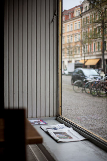 Absence Architecture Book Building Exterior Built Structure Car City Day Education Mode Of Transportation No People Outdoors Paper Publication Selective Focus Table Transportation Window EyeEmNewHere