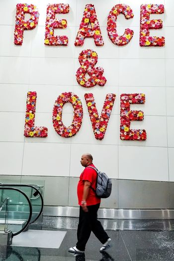 Peace & Love for Humanity Peace&love Airpot Travel Travel Photography Destination Red One Person Message To The World Communication EyeEm Ready   Miamiinternationalairport