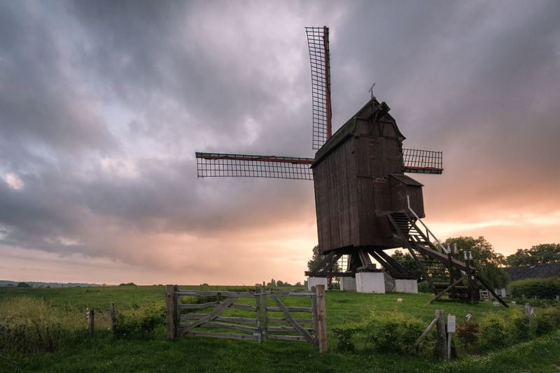 Windmill Sky Cloud - Sky Land Plant Environment Field Nature Landscape Beauty In Nature Grass Rural Scene No People Agriculture Tranquil Scene Outdoors Sunset