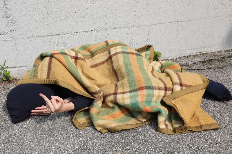 Man sleeping on footpath