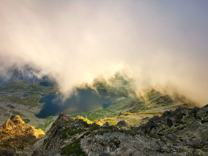 Mountain valley in the clouds lit by the setting sun. tatra mountains slovakia.