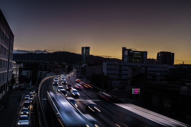 Blurred motion of vehicles on road at sunset