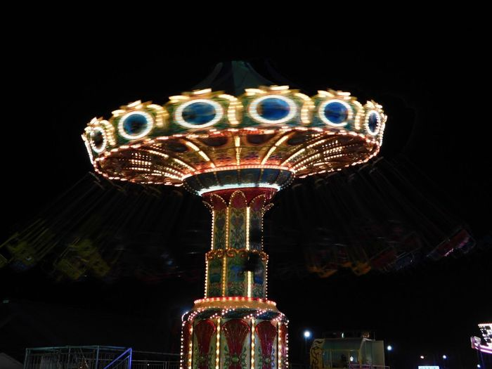 Dizzy on the come down Amusement Park Arts Culture And Entertainment Amusement Park Ride Night Illuminated Low Angle View Carousel