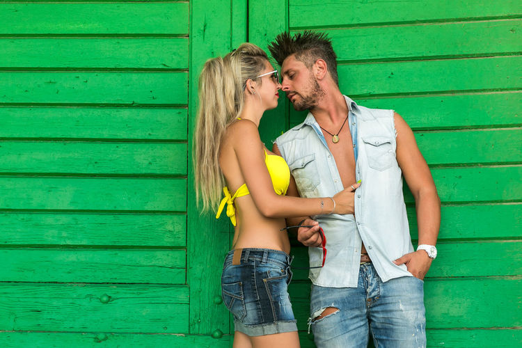 Togetherness Love Casual Clothing Couple - Relationship Young Women Young Adult Emotion Two People Positive Emotion Bonding Men Hair Heterosexual Couple Three Quarter Length Women Romance Young Men Adult Hairstyle Standing Jeans Outdoors Shorts
