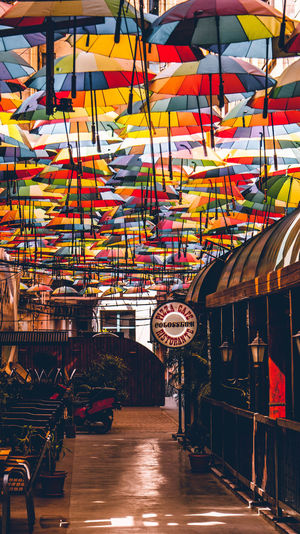 Pasagiul Victoriei Multi Colored Architecture Indoors  Business Large Group Of Objects Market Illuminated Incidental People Market Stall Built Structure For Sale Direction Day Decoration The Way Forward Transportation Real People Men Ceiling Bucharest Umbrella Romantic