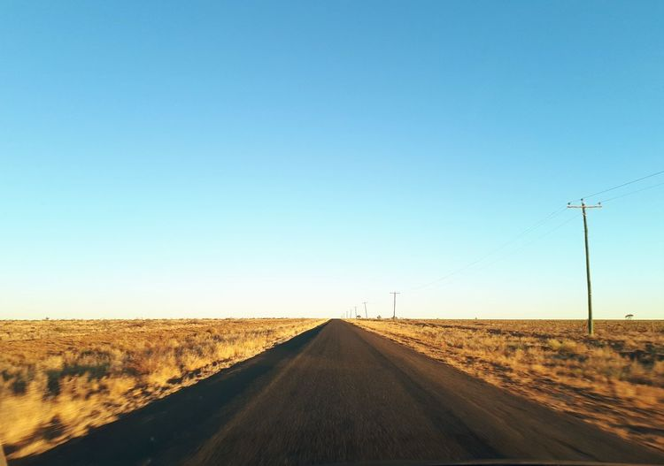 Outback Queensland Queensland EyeEm Selects Cloud - Sky Feild Outback Queensland Australia Queensland Road Flat Looking Ahead Clear Sky Rural Scene Road Blue Desert Sunlight Agriculture Sky Landscape Empty Road Road Marking Telephone Pole Asphalt White Line Country Road Power Line  Straight vanishing point Electricity Pylon The Way Forward