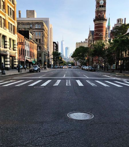 Down yonder in the big city. NYC Urban Streets City Building Exterior Architecture Built Structure Transportation Road Street Road Marking Sky City Street Day Motor Vehicle