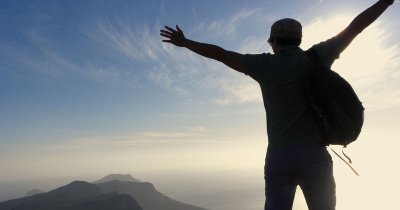 Table Mountain in Cape Town Cape Town Tourist Attraction  Arms Outstretched Arms Raised Beauty In Nature Freedom Human Arm Leisure Activity Lifestyles Limb Mountain Nature One Person Outdoors Real People Rear View Scenics - Nature Sky Standing Tablemountain Tranquil Scene Tranquility