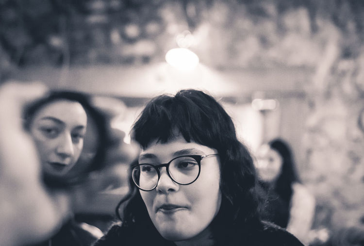 Two women in the same eye. Headshot Eyeglasses  Portrait Focus On Foreground Glasses Real People Lifestyles Young Adult Women Young Women Adult People Leisure Activity Two People Looking At Camera Front View Looking Night Togetherness Close-up Hairstyle