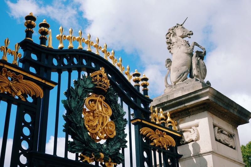 Low angle view of entrance gate against sky at buckingham palace