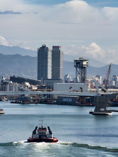 Ships and buildings in port of barcelona