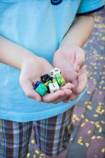 Boys Childhood Close-up Day Dice Human Body Part Human Hand Leisure Activity Lifestyles One Person Outdoors People Playing Real People