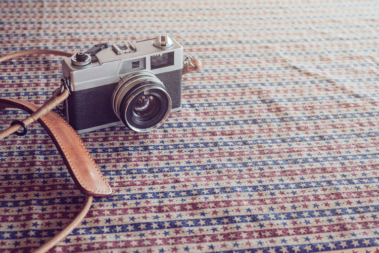 Vintage 35mm Film Camera Photography Themes Technology Camera - Photographic Equipment No People Indoors  Single Object Still Life High Angle View Retro Styled Photographic Equipment Close-up Table Camera Photographing Nostalgia Pattern Carpet - Decor Arts Culture And Entertainment Lens - Optical Instrument Digital Camera Film Film Photography Film Industry Filmcamera Vintage Vintage Style Lifestyles Life Is A Beach Vintage Sunglasses Travel Travel Destinations Travel Photography Travelling