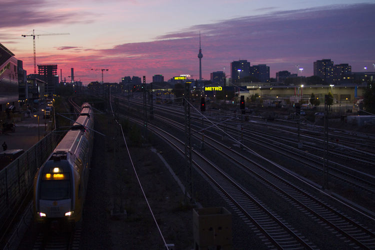 Berlin Rail Transportation Track Railroad Track Train Sky Transportation Sunset Public Transportation Train - Vehicle Mode Of Transportation Cloud - Sky Architecture Built Structure Illuminated High Angle View No People Travel Building Exterior Dusk City Outdoors Electricity  Station
