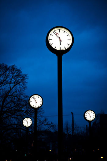 Low Angle View Of Clock Against Sky At Dusk